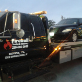 A PT Cruiser being towed by Fireball Towing