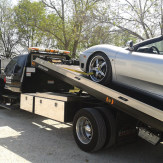 A silver car being towed
