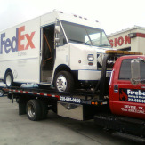 fedex truck being towed by fireball towing
